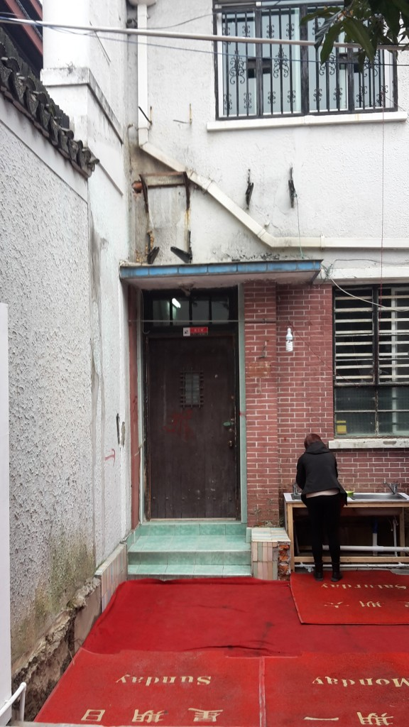 A grubby but interesting combination of wall/doors/windows/hand basin in Shanghai, China