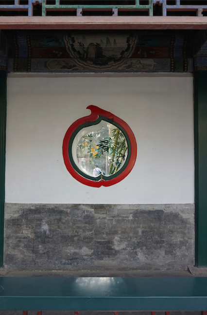 A cute fruit window in a wall in the Summer Palace, Beijing, China