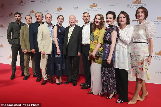 The cast and producers of Downton Abbey on the red carpet at the launch of an exhibition about the television series at the Marina Bay Sands on Wednesday, June 21, 2017, in Singapore. (AP Photo/Joseph Nair)