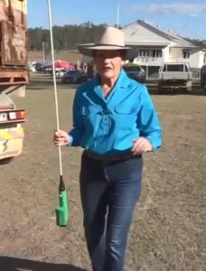 Pauline Hanson in the country wearing blue jeans, a blue shirt and a cowboy hat