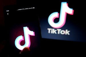 two screens holding up the TikTok logo