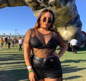 girl at festival wearing see-through outfit