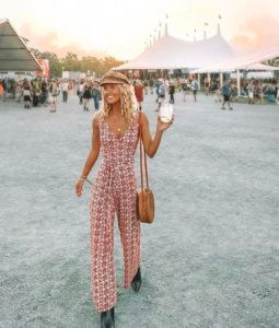 girl at festival wearing a pink 60's or 70's inspired outfit