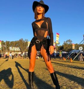 girl at festival wearing black cowgirl outfit