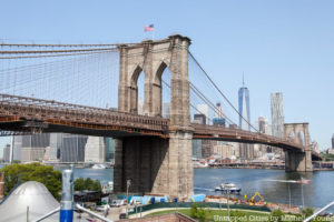 the brooklyn bridge on a sunny day, one of the most well-known US landmarks