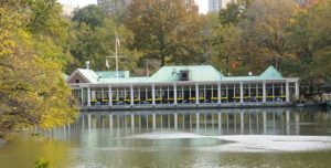 the boathouse over green water surrounded by green trees, one of the most well-known US landmarks