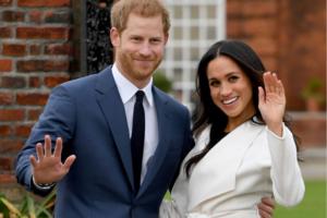 Meghan and harry waving Royal Exodus