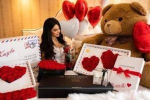 woman surrounded by Valentine's Day gifts from my lasting bouquet