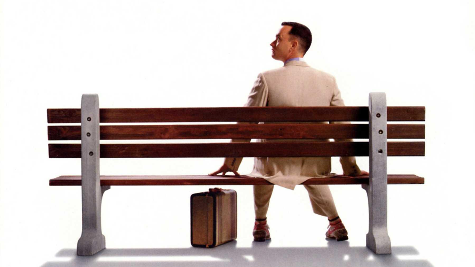 Forest Gump sitting on a bench picture for the throwback movies list