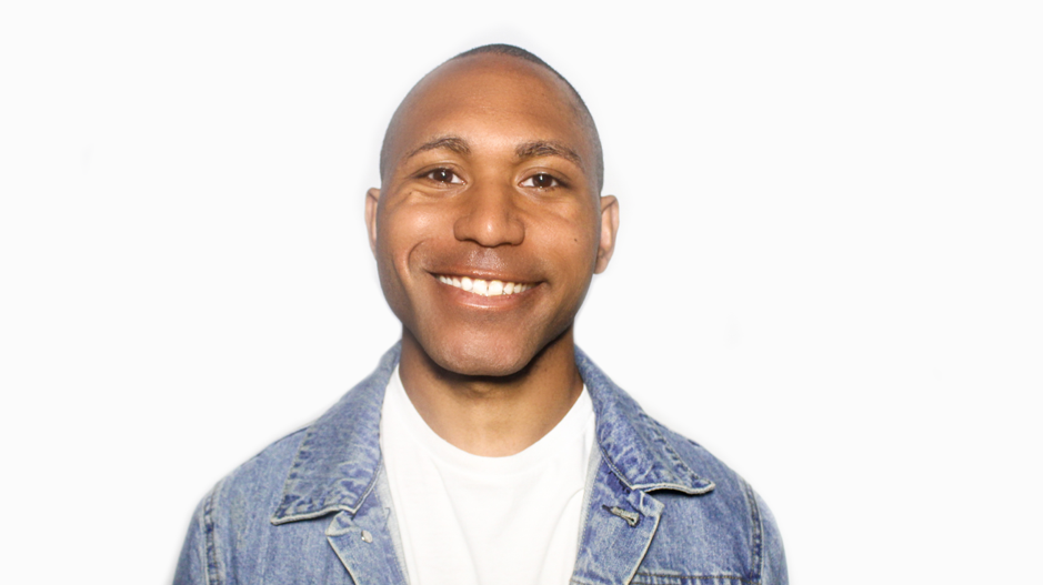picture of an adopted man smiling with a white background