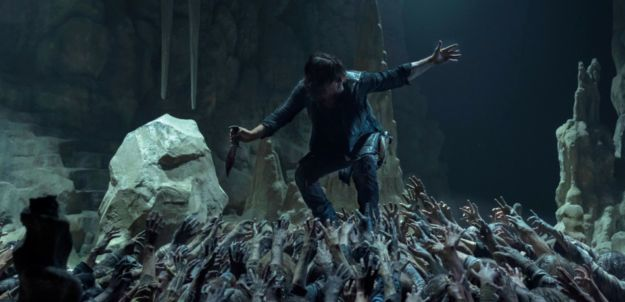 Photo of man atop zombies from the walking dead on Binge