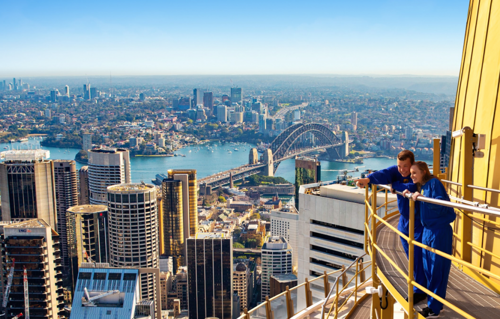 A couple looking at views of the city from the Sydney Tower Eye SKYWALK