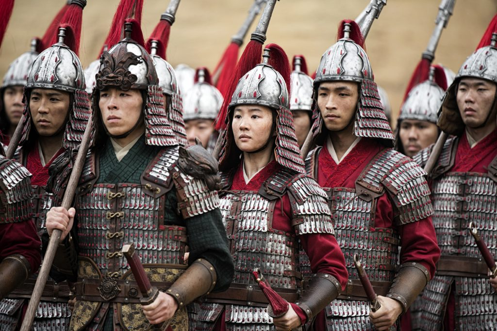 Mulan marching with soldiers in battle