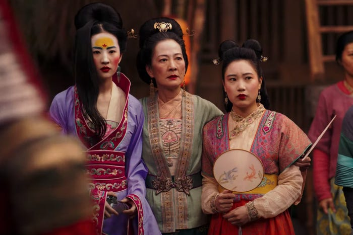 Mulan with her mother and ssiter ready for the matchmaker